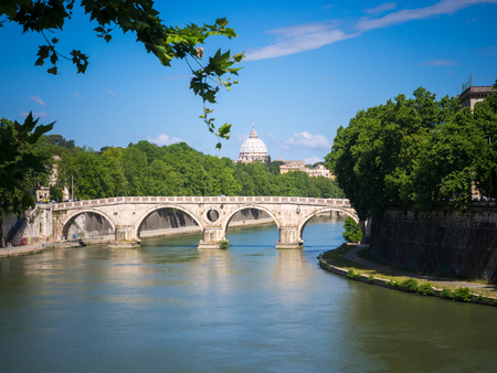 Tiber river in Rome with St Peters cathedral in the background