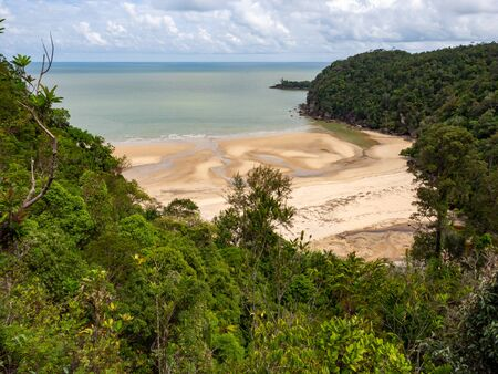 Beach surrounded by rainforest in Bako National Park, Sarawak, Malaysia