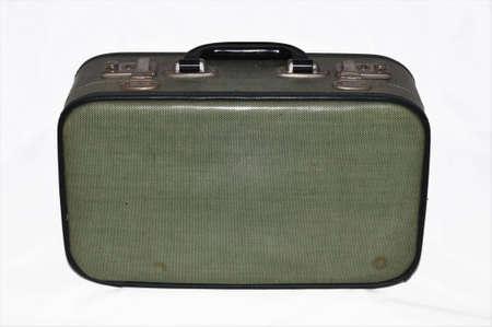 worn retro suitcase isolated on white background
