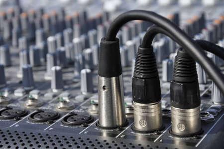 Detailaufnahme eines Mischpultes mit vilen Knöpfen und Reglern  Details include a console with buttons and knobs
