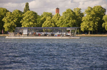 solar boat on the Maschsee in Hanover, Germany Stock Photo