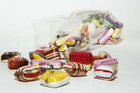 isolated candy on ehite background as symbol for obese Standard-Bild