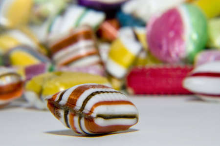 isolated candy on ehite background as symbol for obese Stock Photo