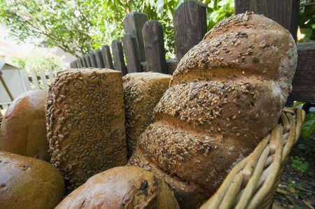bunch of fresh baked  bread in a basket