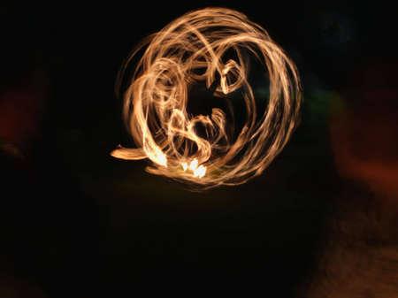 fire show burning wheel at night
