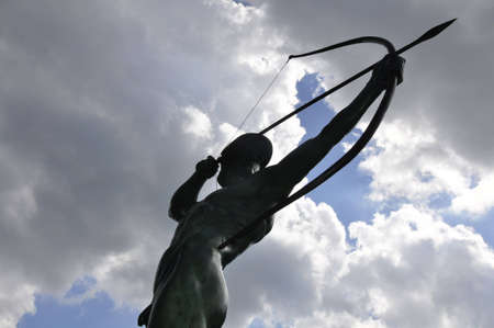 bow and arrow: archer statue in front of the new town hall of Hannover, Germany