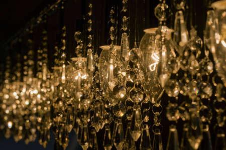electric candelabra yellow shine on black background photo