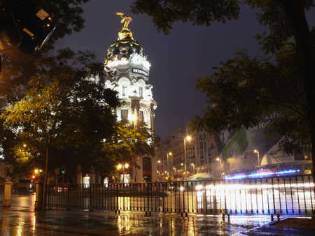 metropolis building in madrid at rainy night