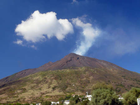 view from the harbour to stromboli volcano Stock Photo