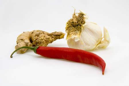 ginger, garlic and chili fruit isolated on white background