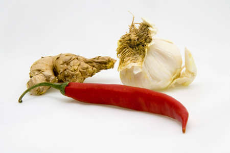 ginger, garlic and chili fruit isolated on white background