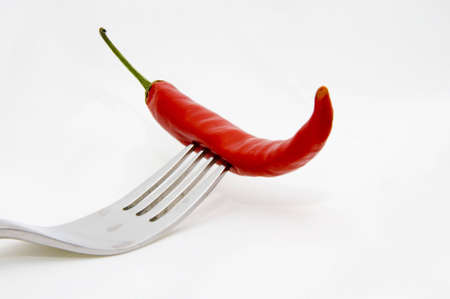 red hot chili with fork isolated on white background Stock Photo