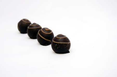 four chocolate candies blured and isolated on white background Stock Photo