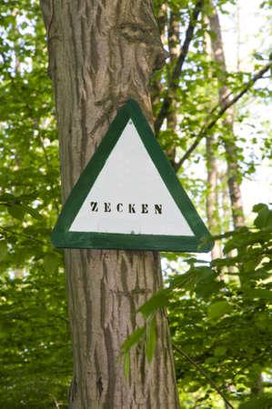 danger ticks sign in a forest