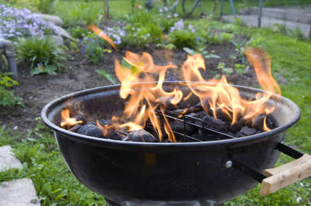 starting barbeque with high and hot flames