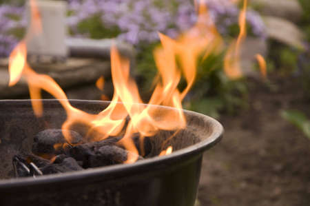cookout: detail of starting barbeque with hot and high flames Stock Photo