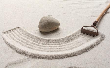 Zen garden with rake and stone