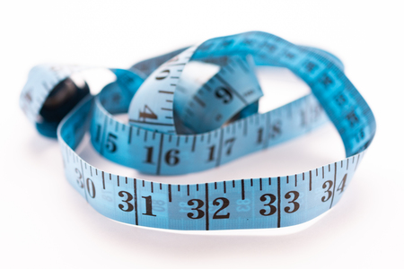 blue tape measure indicating 32 inches Stock Photo