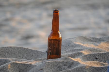 Single bottle in the sand
