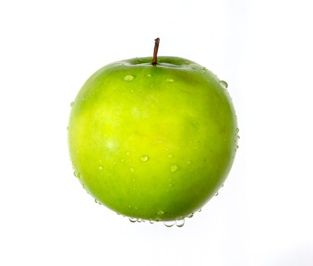 Fresh apple with water drops falling