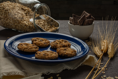 Cookies in blue plate with some ingredients