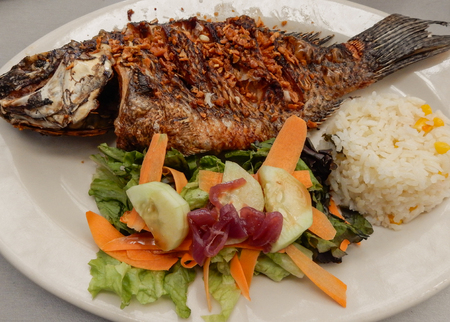Mojarra with fried garlic and salad