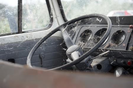 campervan: Old campervan steering wheel covered in cobwebs