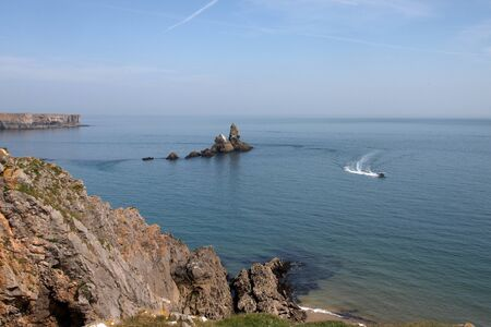 pembrokeshire: A boat on the water at Skrinkle Haven in Pembrokeshire