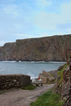 slipway: A boat on a slipway with cliffs and sea in the background Stock Photo