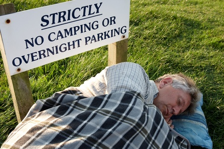 breaking the rules: breaking the rules and sleeping rough Stock Photo