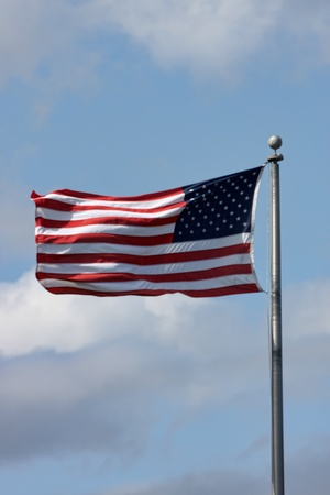 wavering: The American flag wavering in the wind