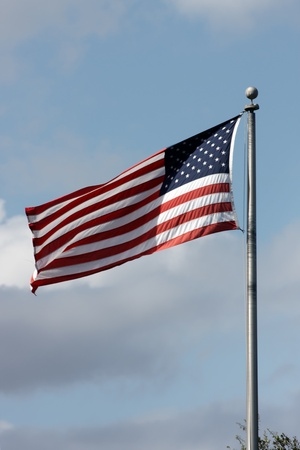 wavering: The American Flag with blue sky background