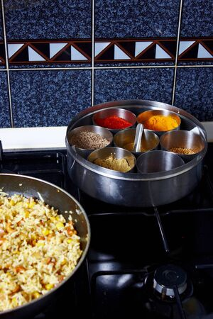 A display of colourful spices and rice in a pan Stock Photo - 13322931