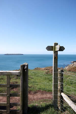 Coastal path sign post with the sea in the background Stock Photo - 13639949