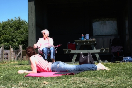 grand daughter: Grandmother and grand daughter having a picnic