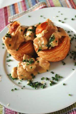 Vol au vent stuffed with chicken and creamy sauce photo