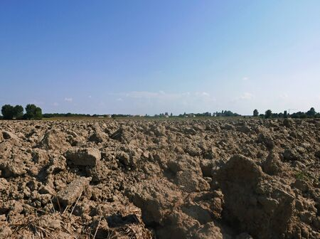 rural view of a large expanse of field with loose clods Standard-Bild