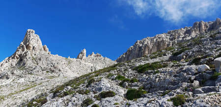 the imposing mountains of the dolomites in italy in summer