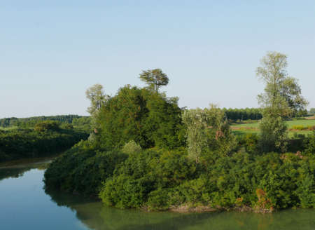 relaxing rural landscape along the banks of the river Stok Fotoğraf