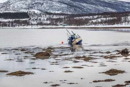 The ship ran aground as a result of the storm. Lofoten, Norway. 写真素材
