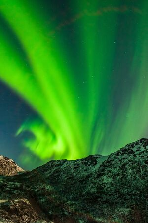 northern lights, Polar lights over mountains in the North of Europe , Lofoten islands, Norway, long shutter speed. Stockfoto