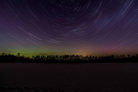 Star Tracks during the Aurora borealis, Sweden. long exposure