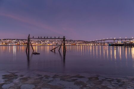 sunrise with amazing magenta color over Tromso, Norway. Winter. Polar night. long shutter speed