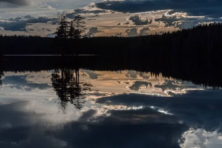 Sunrise over the lake with the reflection in the water, long shutter speed