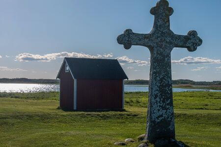 old stone cross nearSaint Birgittas chapel ruin on a sunny spring day. Kapelludden on Oland, Sweden. Banco de Imagens