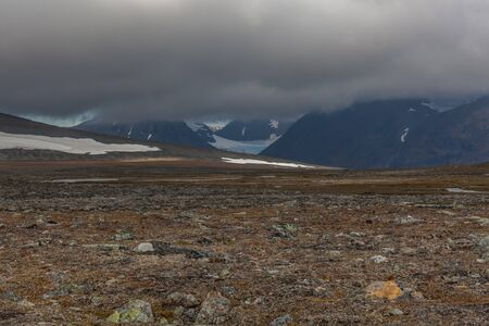 View of the valley. Northern Sweden, Sarek National Park in stormy weather. selective focus Standard-Bild - 140373512
