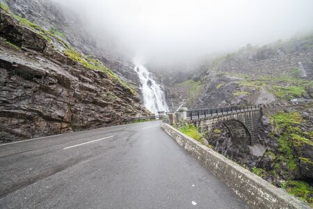 trollstigen waterfall and bridge. Norway, selective focus 스톡 콘텐츠