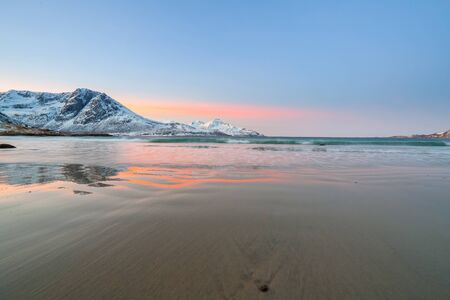sunrise with amazing magenta color over sand beach and fjord. Tromso, Norway. Winter. Polar night. long shutter speed Stockfoto - 141667195