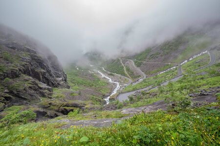 Turn of the mountain road. The view from the height of the trollstigen, Norway, selective focus. 版權商用圖片