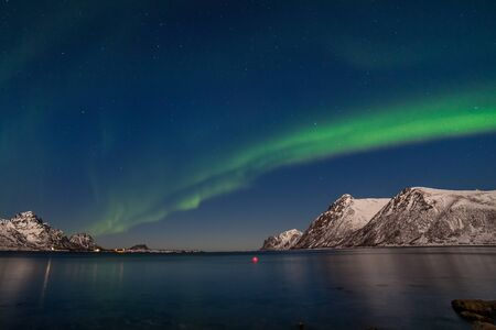A wonderful night with Kp 5 northern lights flying over the mountains, long shutter speed. Stockfoto